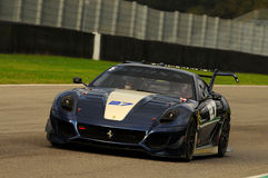 MUGELLO, ITALIA - NOVEMBRE 2013: Lo sconosciuto guida Ferrari 599XX durante XX i programmi di Finali Mondiali Ferrari - il giorno Fotografie Stock