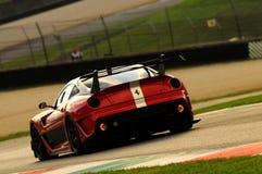 MUGELLO, ITALIA - NOVEMBRE 2013: Lo sconosciuto guida Ferrari 599XX durante XX i programmi di Finali Mondiali Ferrari - il giorno Immagine Stock