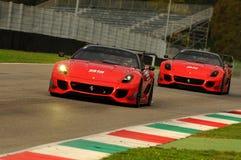 MUGELLO, ITALIA - NOVEMBRE 2013: Lo sconosciuto guida Ferrari 599XX durante XX i programmi di Finali Mondiali Ferrari - il giorno Immagine Stock Libera da Diritti
