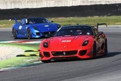 MUGELLO, ITALIA - OTTOBRE 2017: Lo sconosciuto guida Ferrari 599XX durante XX i programmi di Finali Mondiali Ferrari al circuito  Fotografia Stock Libera da Diritti