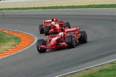 MUGELLO, IT, November, 2007: Official Drivers Felipe Massa, Kimi Raikkonen, Luca Badoer and Marc Genè run with Modern Ferrari F1 Stock Image