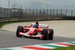 MUGELLO, IT, November, 2013: onbekende looppas met Ferrari F1 tijdens Finali Mondiali Ferrari 2013 in de mugellokring Stock Afbeeldingen