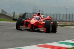 MUGELLO, IT, November, 2013: onbekende looppas met Ferrari F1 tijdens Finali Mondiali Ferrari 2013 in de mugellokring Stock Foto's