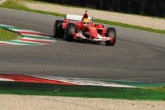 MUGELLO, IT, November, 2013: onbekende looppas met Ferrari F1 tijdens Finali Mondiali Ferrari 2013 in de mugellokring in Italië Stock Fotografie