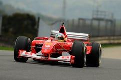 MUGELLO, IT, November, 2013: onbekende looppas met Ferrari F1 tijdens Finali Mondiali Ferrari 2013 in de mugellokring in Italië Stock Foto's