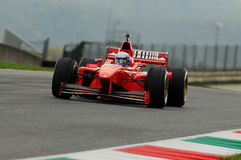 MUGELLO, IT, November, 2013: unknown run with Ferrari F1 during Finali Mondiali Ferrari 2013 into the mugello circuit Stock Photos