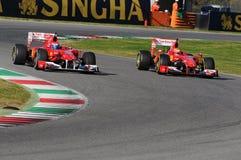 MUGELLO-STRÖMKRETS, ITALIEN - OKTOBER: Sebastian Vettel, Kimi Raikkonen, Marc Genè och Esteban Gutierrez av Scuderia Ferrari F1 Fotografering för Bildbyråer