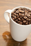 Mugg of coffee beans Royalty Free Stock Photo