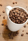 Mugg of coffee beans royalty free stock images