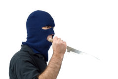 Mugger. Isolated mugger with a knife and wearing a balaclava royalty free stock image