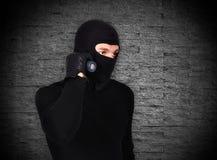 Mugger with flashlight Royalty Free Stock Images
