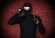 Mugger with flashlight Stock Photography