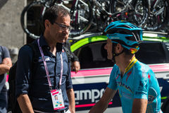 Muggiò, Italy May 26, 2016; Michele Scarponi and Davide Cassani speak before the start of  the stage Royalty Free Stock Photography