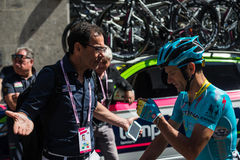 Muggiò, Italy May 26, 2016; Michele Scarponi and Davide Cassani speak before the start of  the stage Stock Photo