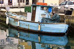 Muggia, Italy - Vintage blue fisher boat Royalty Free Stock Photography