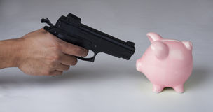 Mugging a Piggy Bank Royalty Free Stock Photo
