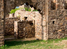 Mughal arch opening into a ruined building. Mugal architecture styled arch opening into the ruins of a stone building. Situated in Bhangarh Rajasthan Royalty Free Stock Photos