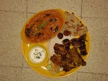 Mughal food palate. It contains two gravies first brinjal gravy other mayonnaise with butter nan and tandoori chicken.also chicken nuggets stock images