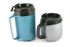 Mugs. Double wall insulated mug isolated on white Stock Images