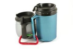 Mugs. Double wall insulated mug isolated on white Stock Image