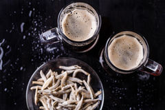 Mugs with beer with anchovies Royalty Free Stock Image