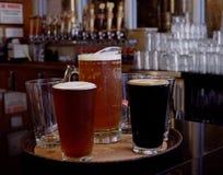Mugs of beer at bar Royalty Free Stock Photos