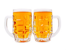 A mugs of beer closeup view Stock Images