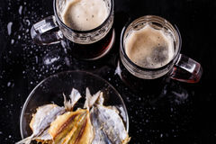 Mugs with beer with fish Stock Photos