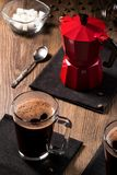 Mugs of coffee on black napkins near the coffee maker Royalty Free Stock Photography
