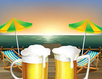 Mugs of cold beer at the beach Stock Photo