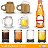 Mugs, glasses and a bottle of beer Royalty Free Stock Photos