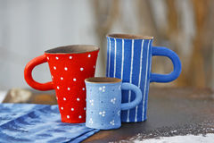 Mugs handmade. Based on the tale of the Three bears, author Irina Tyuleneva Stock Photo