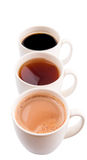 Mugs Of Hot Beverages V. Mugs of hot beverages of chocolate, tea and black coffee over white background Royalty Free Stock Images