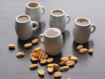 Mugs with light beer and salted peanuts royalty free stock photos