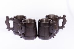 Beer mugs made of wood on a neutral white background. royalty free stock photos