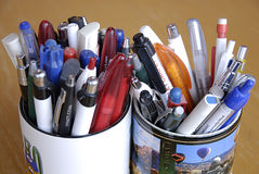 Mugs with pens Royalty Free Stock Photography