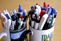 Mugs with pens Stock Image