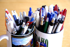 Mugs with pens Royalty Free Stock Image