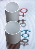 Mugs with shaped handles. White mugs with shaped handles Royalty Free Stock Image