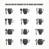 Mugs and spoons Stock Images