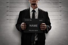 Mugshot da placa criminosa do nome da posse foto de stock royalty free