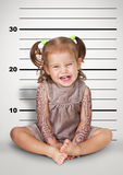 Mugshot of Funny naughty baby with tattoo, disobedient child con Royalty Free Stock Photo
