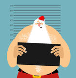 Mugshot Santa in police. Bad Claus criminal. Naughty Santa with Royalty Free Stock Photo