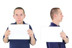 Mugshot of young man. Young man posing for mug shot - front and side with white sign Stock Image