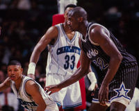 Mugsy Bogues against Shaquille O'Neal Stock Photo