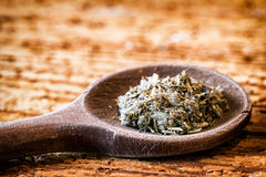Mugwort. Incense on an old kitchen spoon - mugwort Royalty Free Stock Images