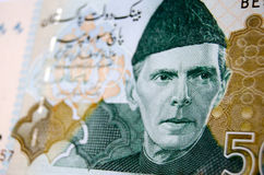 Muhammad Ali Jinnah on banknote. Muhammad Ali Jinnah, founder of Pakistan, printed on a used Pakistan banknote for 500 Rupees.  Image taken at an angle, less Royalty Free Stock Photos