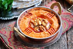 Muhammara dip of sweet peppers with walnuts, cumin, garlic and olive oil. Royalty Free Stock Images