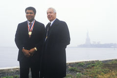 Muhammed Ali and Joe DiMaggio. Wearing gold medals, Ellis Island, NY Royalty Free Stock Photo