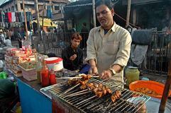 Muharram food. Man selling kebabs on the roadside during Muharram , India Stock Photography
